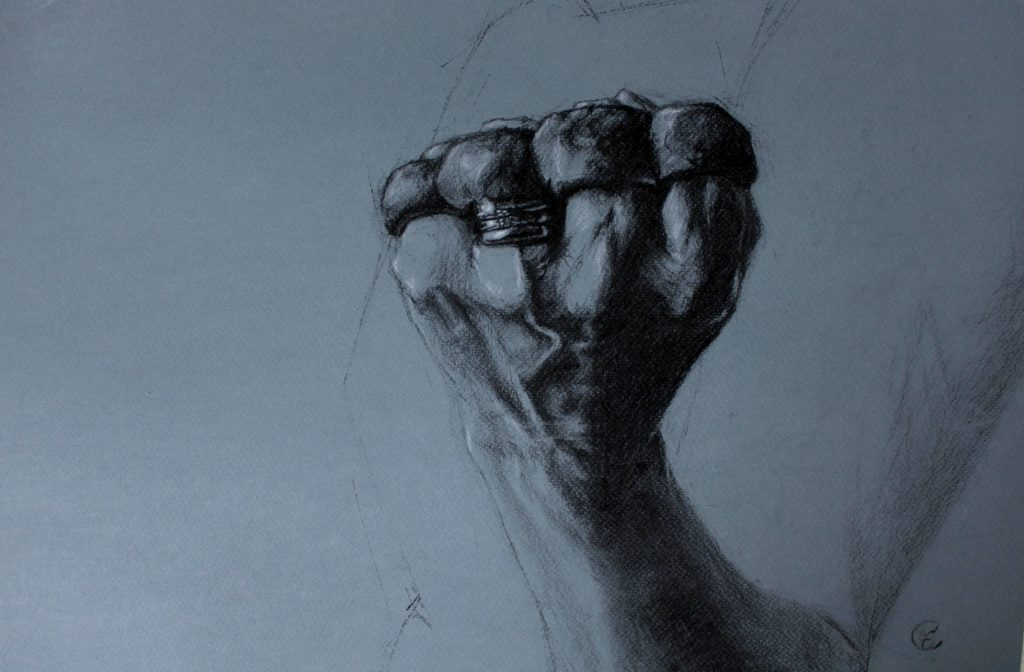 Charcoal drawing on toned paper of a womans hand wearing a knuckleduster